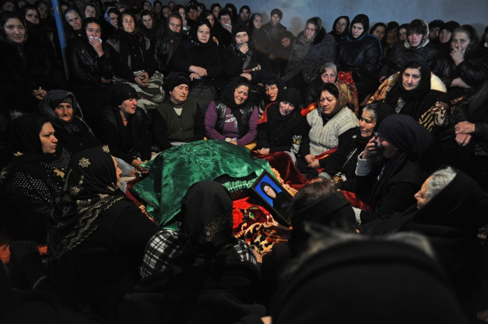 Women mourn during the crying ceremony during the seven day ceremony, part of Azerbaijan's elaborate funeral rituals that include gender segregated commemorations of the deceased three days, seven days and 40 days after their death in Zayam, Azerbaijan on January 3, 2012. Zayam is approximately four kilometers from the BTC pipeline.  Compensation funds paid totaled under $1,000 during the pipeline construction went to keeping the deceased healthy and caring for her daughter who suffers from tuberculosis.