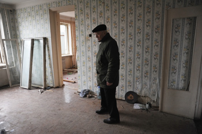 Khaliq Bagirov, 72, stands in the shell of his former living room in his partially demolished apartment at 5 Agil Guliyev Street, a building which was previously occupied by military families and stood beside the newly built Crystal Hall, the planned site for the Eurovision Song Contest, in Baku, Azerbaijan on February 18, 2012.  Bagirov lived in the apartment with his son, his wife and his two grandchildren until the government forced their eviction to clear the area surrounding Crystal Hall ahead of the Eurovision Song Contest.