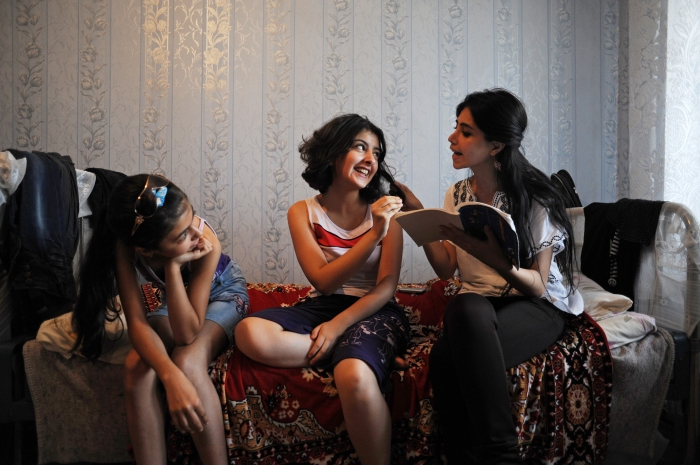 (Center) Gamar Tagili, 15, is quizzed on biology by her cousin Ayten (right) as her cousin Fatima (left) looks on in the Tagi family bedroom in Baku, Azerbaijan on August 18, 2012.