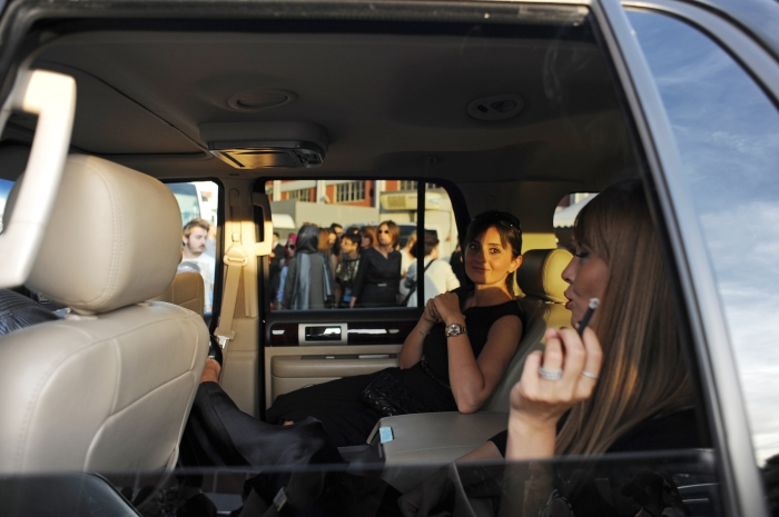 Two women are seen in the backseat of an SUV exiting Istanbul Fashion Week outside Antreppo 3, a warehouse-like venue on the Boshporous in Tophane, after the Soul by Ozgur Masur fashion show in Istanbul, Turkey on October 12, 2012.