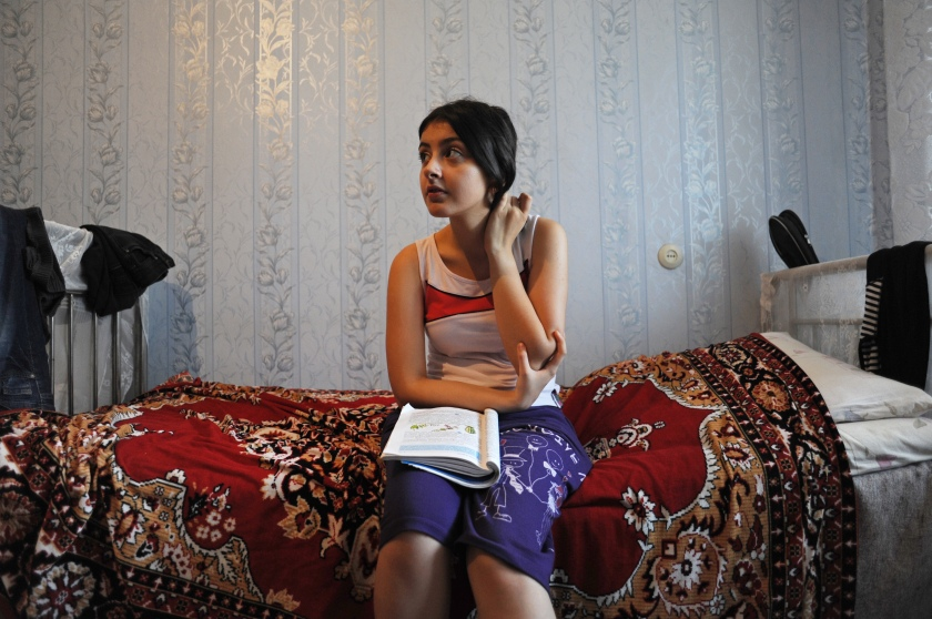 Gamar Tagili, 15, studies for a biology exam in the Tagi family bedroom in Baku, Azerbaijan on August 18, 2012.